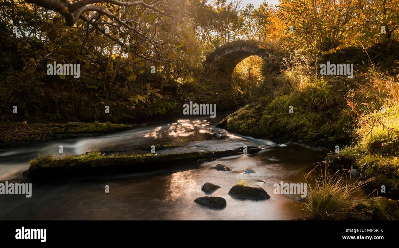 Packhorse bridge over the river Livet, Glenlivet, Scottish Highlands, Scotland, UK - Stock Image