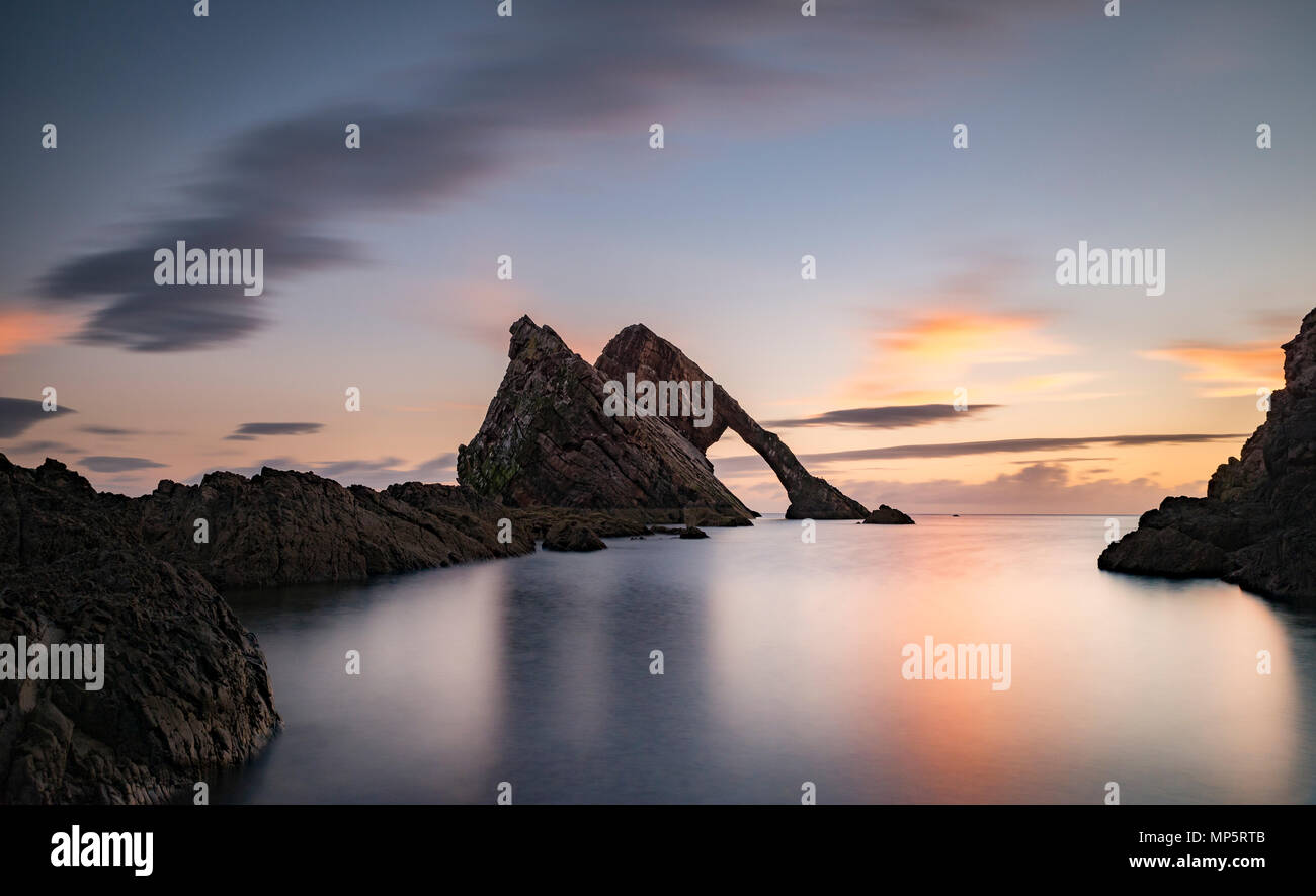 Sunset at Bow Fiddle Rock on the Scottish coastline at Portknockie, Moray, Scotland, UK - Stock Image