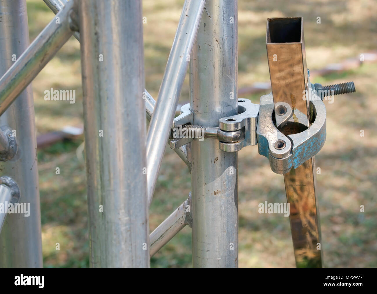 Close up metal scaffolding clamps. - Stock Image