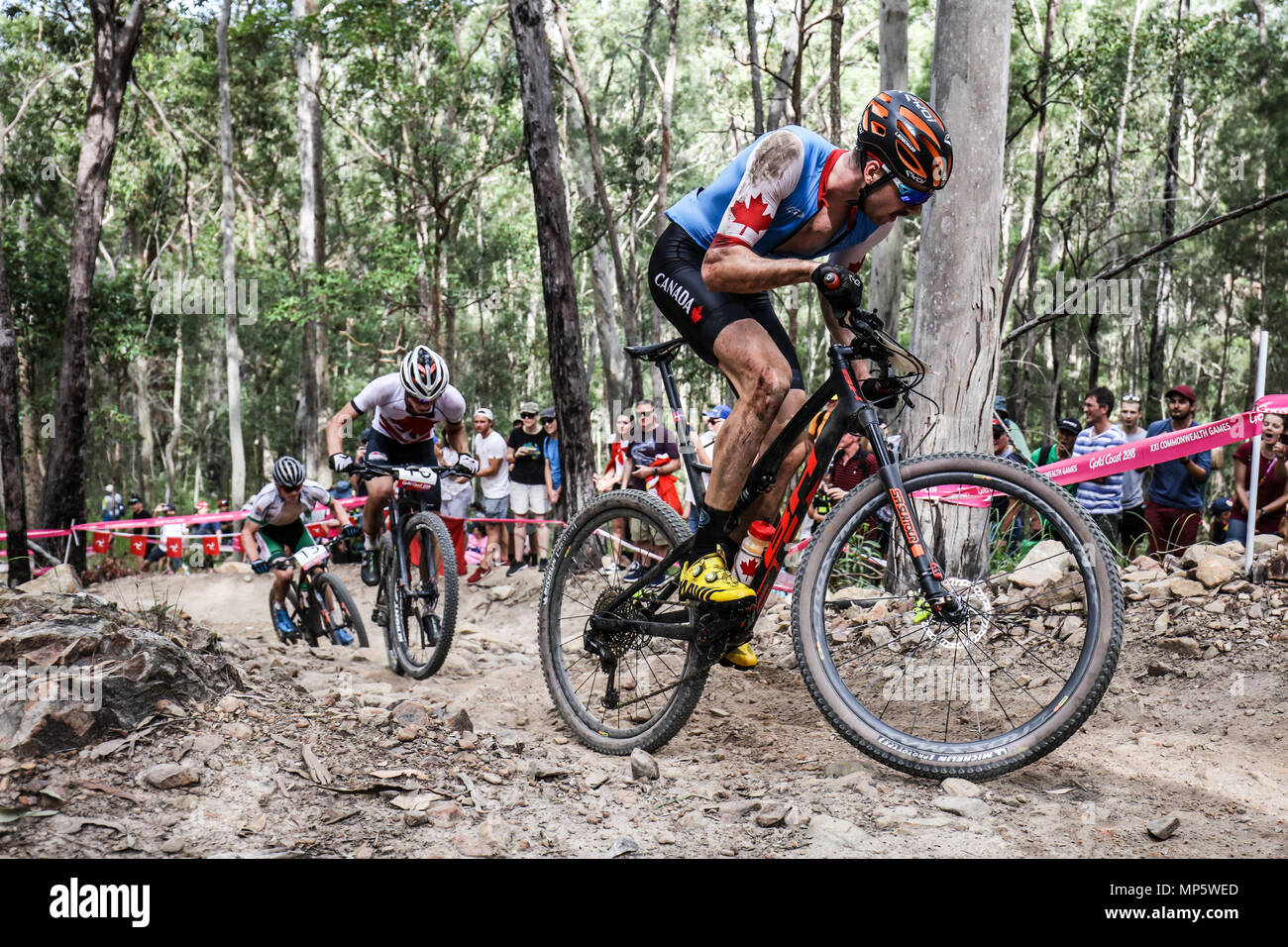 GOLD COAST, AUSTRALIA - APRIL 12: Leandre BOUCHARD (CAN) tackles the hills during the Men's Cross Country Mountain Biking on April 12th 2018 - Stock Image