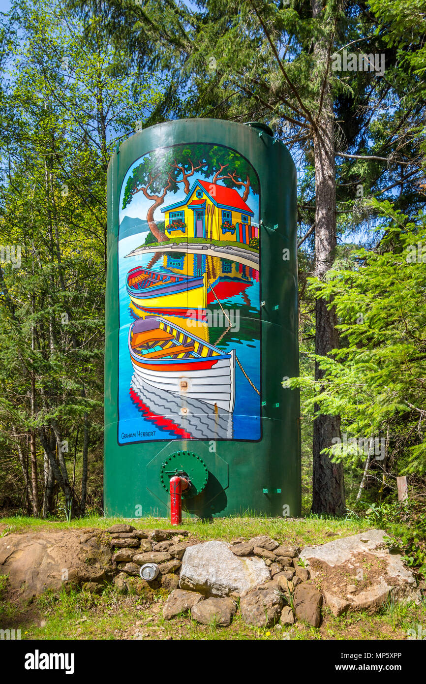Artist painted fire department water tanks, Hornby Island, BC, Canada. - Stock Image