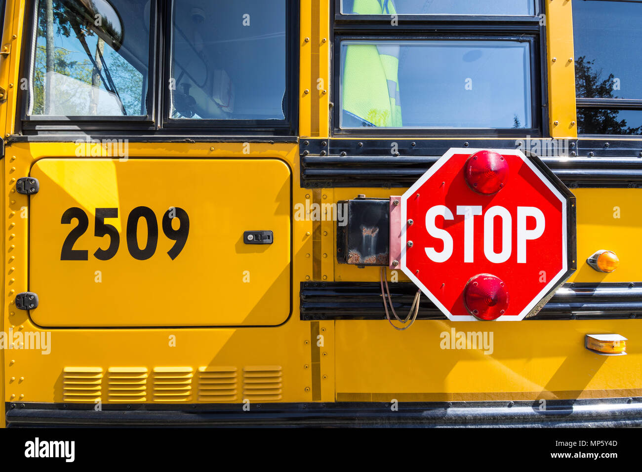 Stop sign on School bus, Hornby Island, BC, Canada. - Stock Image