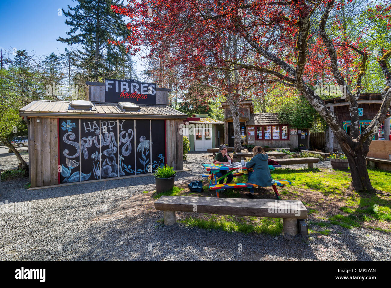 'Fibres' clothing gift shop with artwork on wall, Hornby Island, BC, Canada. - Stock Image