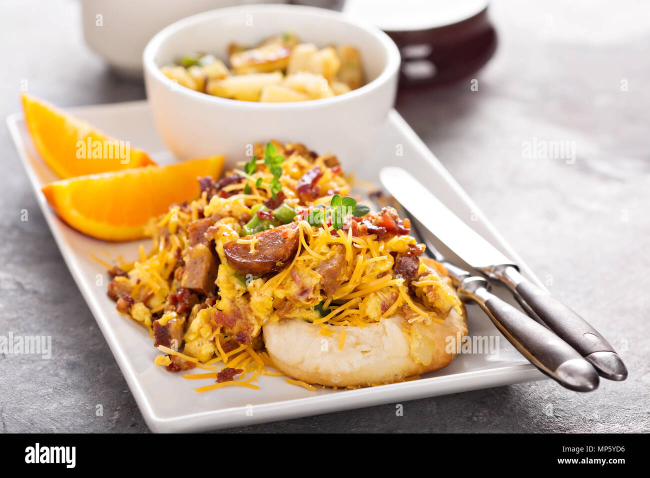 Breakfast biscuits with scrambled eggs - Stock Image