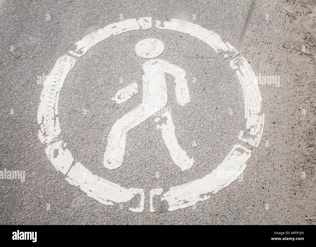 The Symbol Of Man Walking In A Circle On The Asphalt Stock Photo