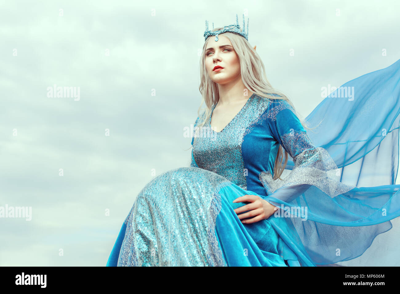 Portrait of a beautiful young woman elf in a blue dress. - Stock Image