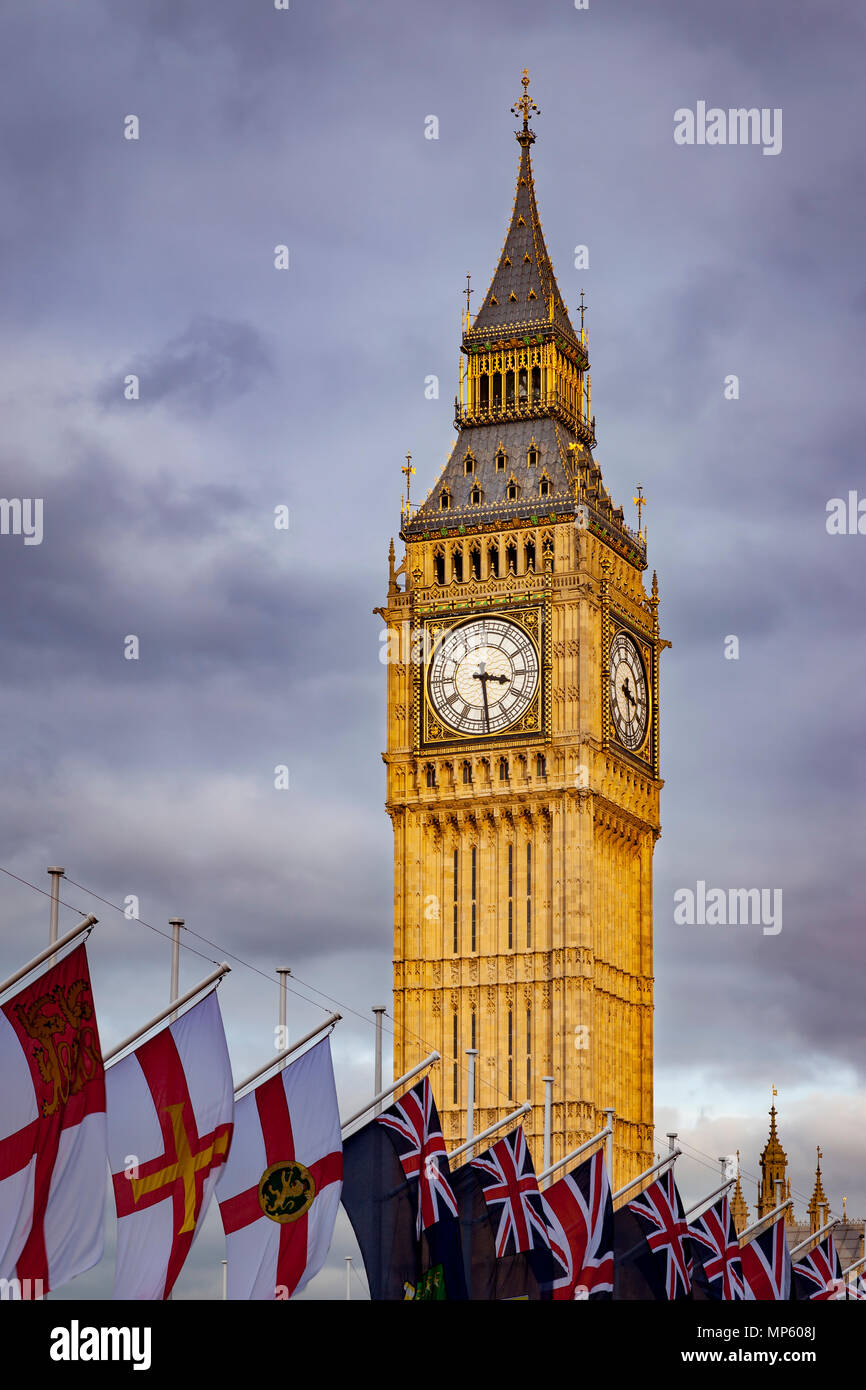 Big Ben towers over flags of the British Commonwealth, London, England, UK - Stock Image