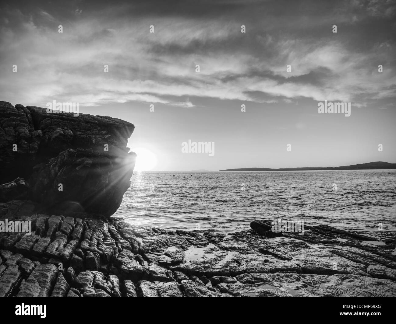 Rocks near Elgol,  Loch Scavaig,  Isle of Skye Scotland. Warm sunset colors in cold February evening. Popular photographers destination. - Stock Image