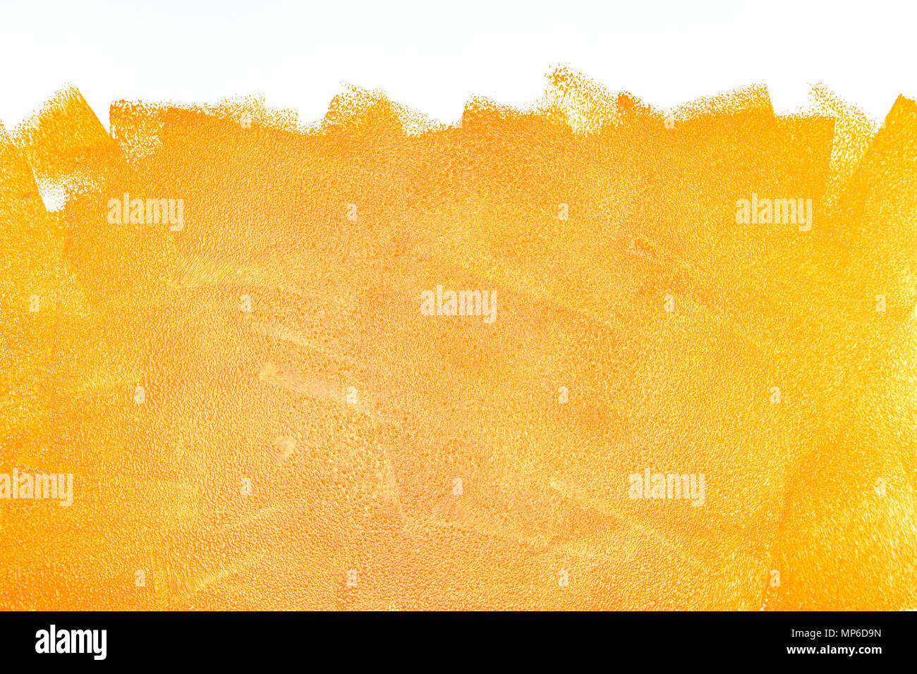 orange acrylic paint roller strokes texture on white wall Stock