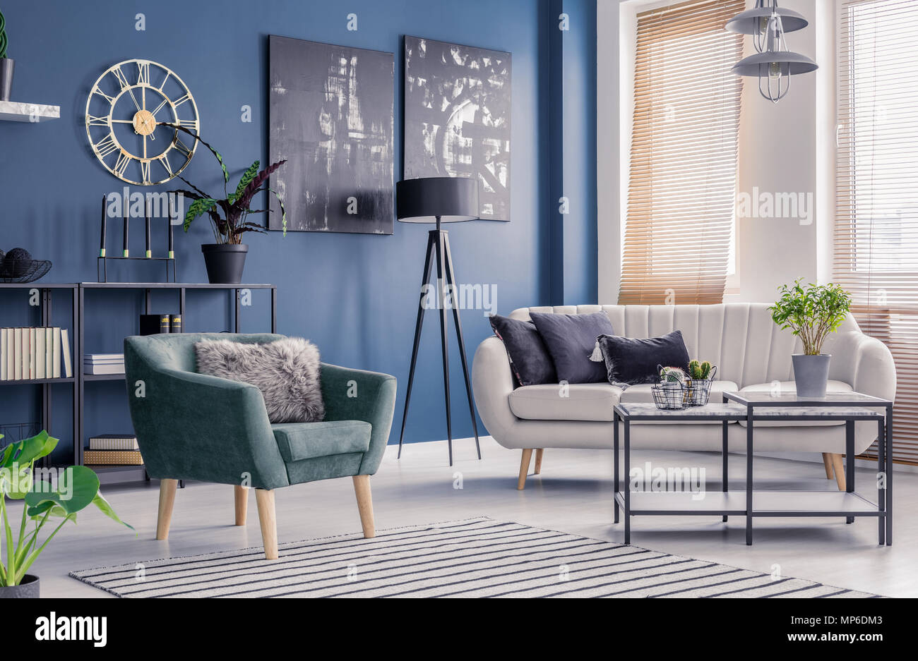 Picture of: Navy Blue Living Room Interior With Designer Decor Black Artwork And Elegant Comfortable Sofa And Armchair Stock Photo Alamy