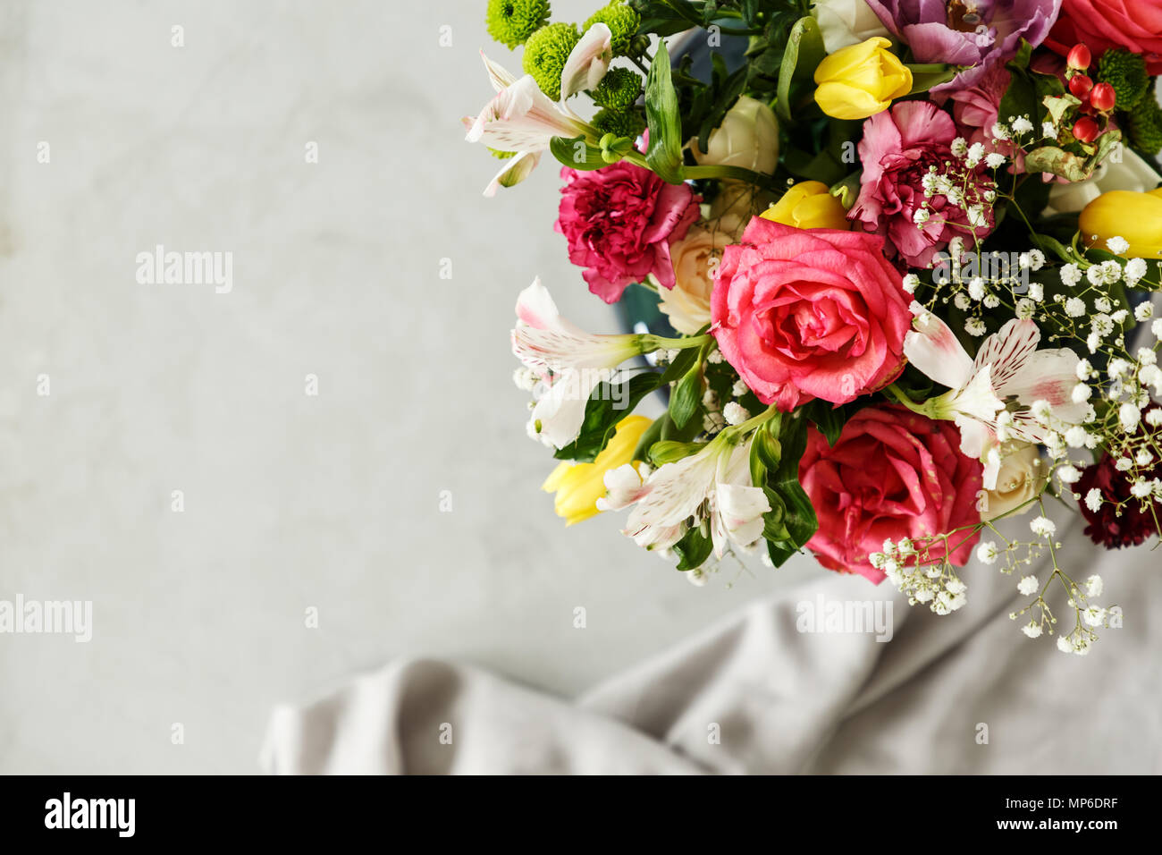 Top View Of A Colorful Bouquet Of Beautiful Flowers In The Corner