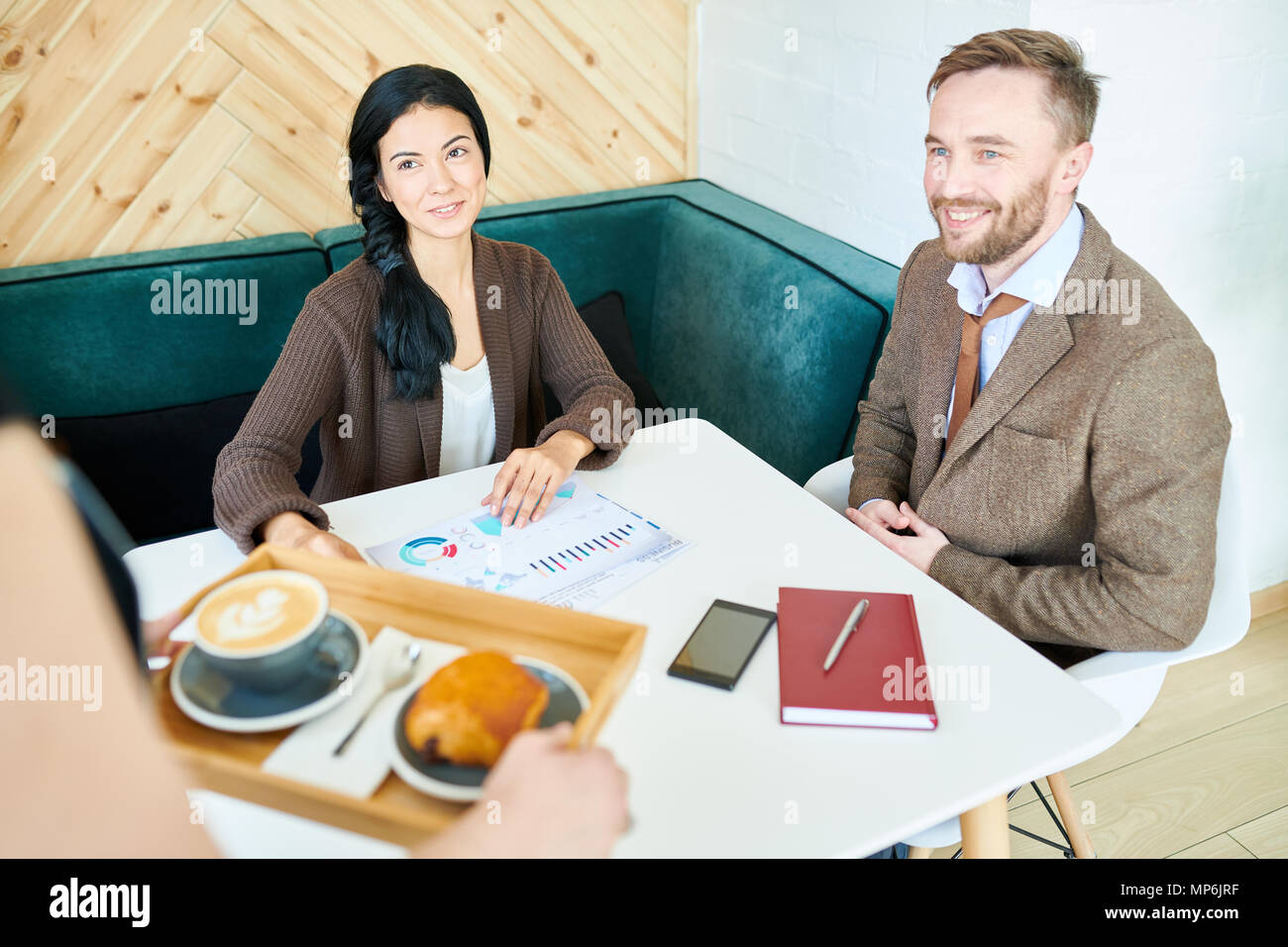 Business People Meeting in Cafe - Stock Image