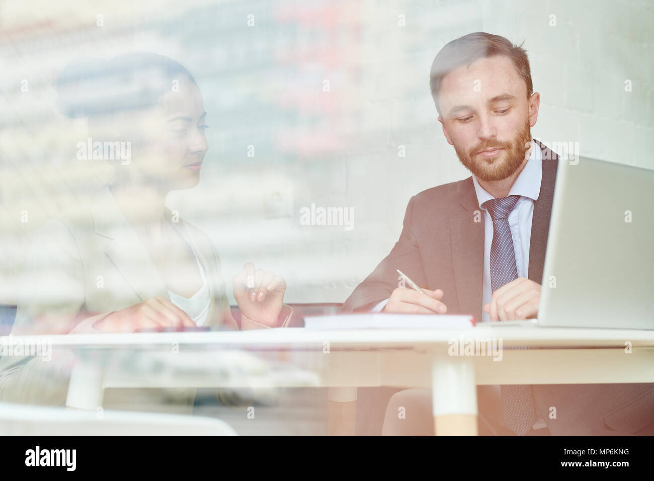 Handsome Businessman Behind Glass Wall - Stock Image