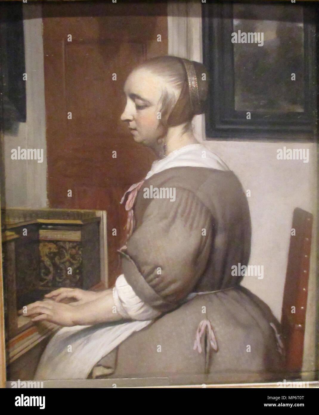 Woman at the virginal .  Français: Gabriel Metsu (1629-1667), Femme au virginal (v. 1662), huile sur bois, collections Petit Palais (Paris). . 1662. Gabriel Metsu 886 Metsu Virginal (cropped) Stock Photo