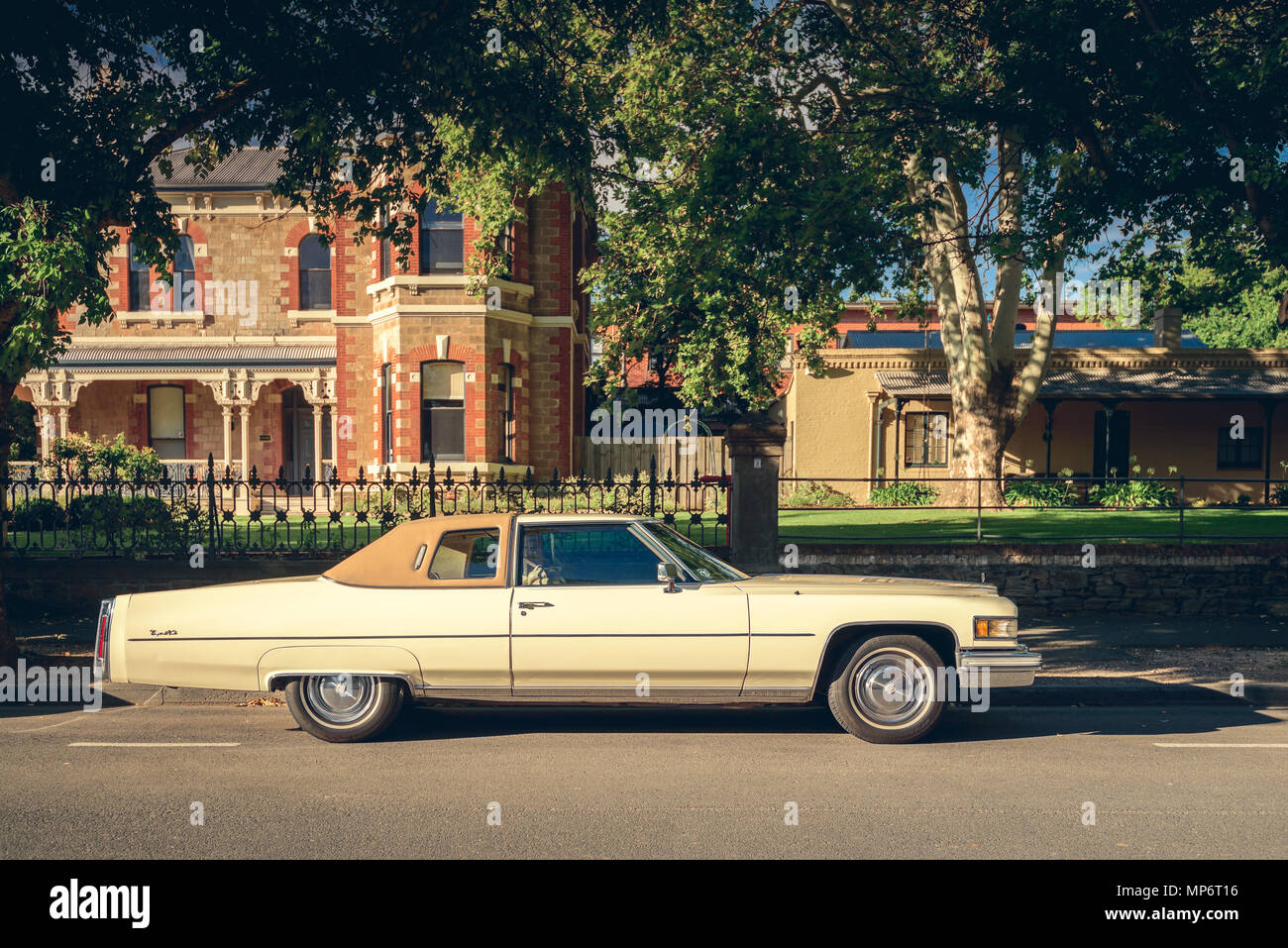 Adelaide, Australia - January 18, 2015: Legendary American Cadillac de Ville car parked in Adelaide city centre on the street on a bright day - Stock Image