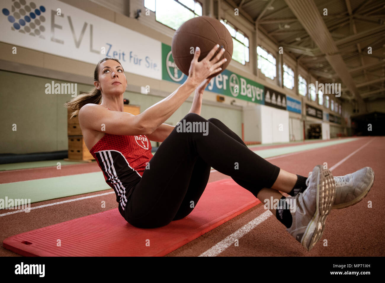 11 May 2018, Germany, Leverkusen: Pole-jumper Katharina Bauer of TSV Bayer 04 Leverkusen trains with a medicine ball. Photo: Marius Becker/dpa - Stock Image