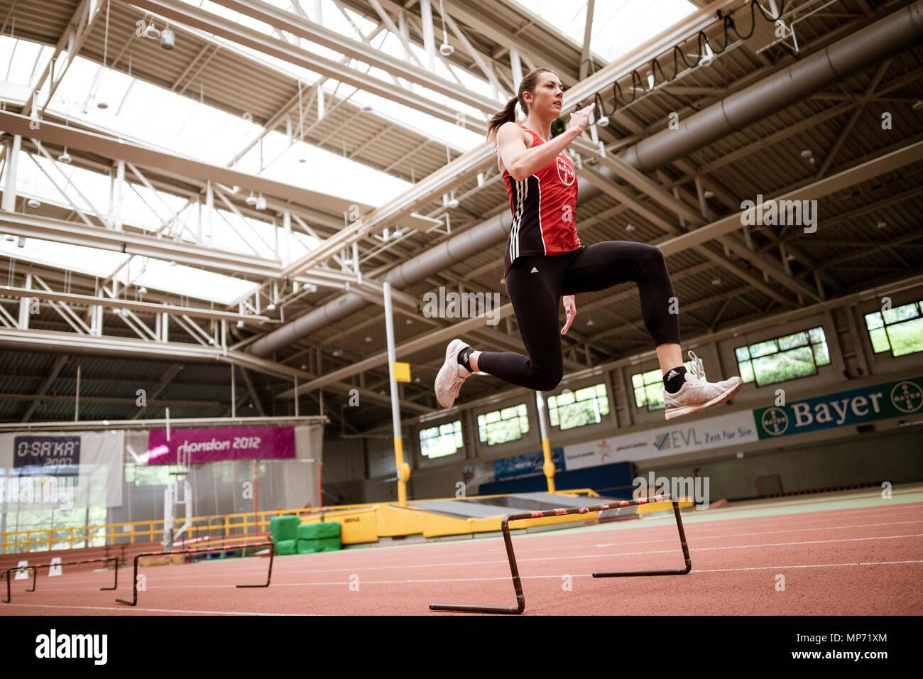 11 May 2018, Germany, Leverkusen: Pole-jumper Katharina Bauer of TSV Bayer 04 Leverkusen jumps over mini-hurdles. Photo: Marius Becker/dpa - Stock Image