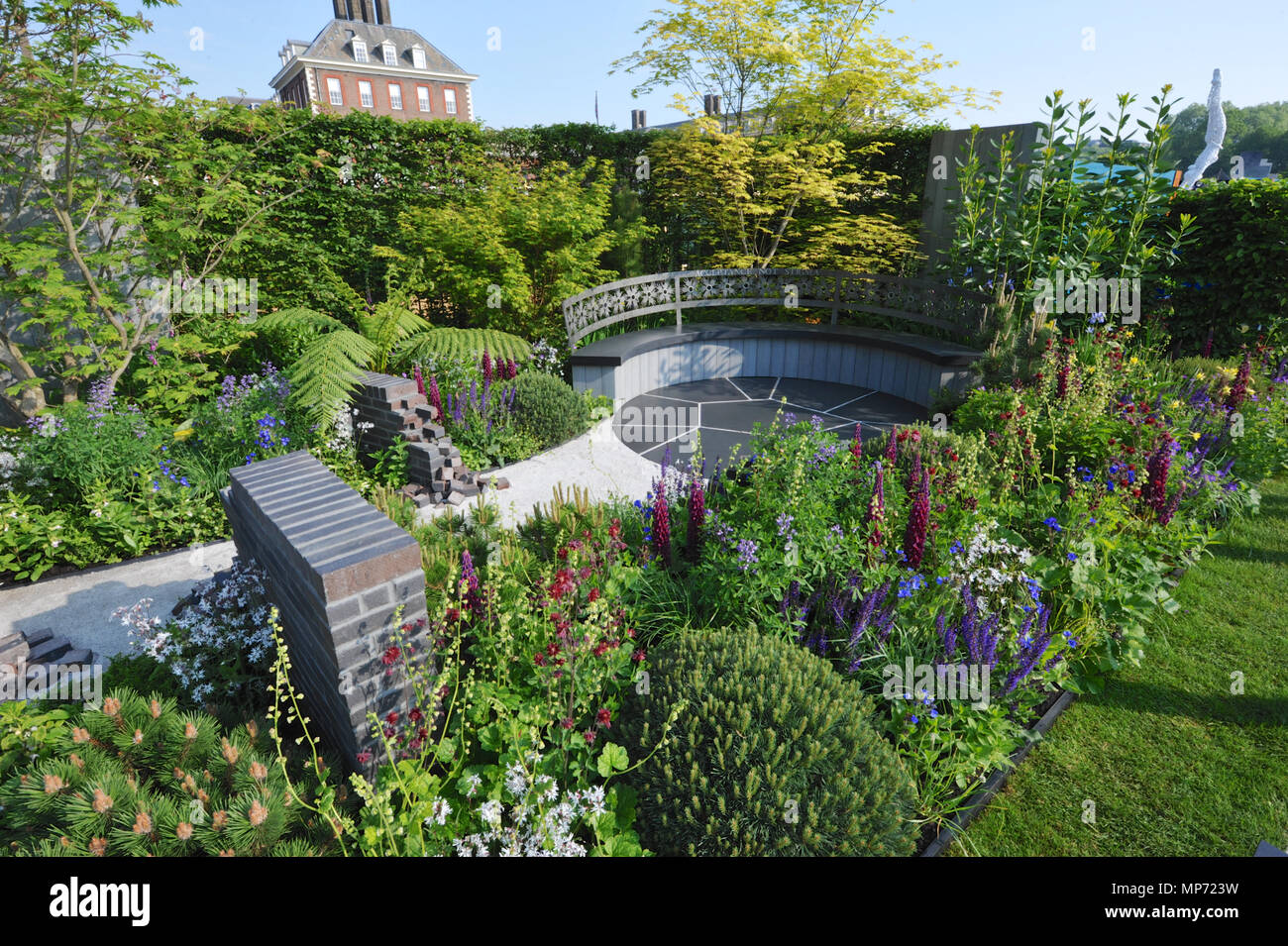 London, UK. 21st May 2018. The CHERUB HIV Garden: (A Life Without Walls),  (designed by Naomi Ferrett-Cohen), one of the beautiful and elegant show gardens on display at the 2018 RHS Chelsea Flower Show which opened today in the 11-acre grounds of the Royal Hospital Chelsea, London, United Kingdom.   Credit: Michael Preston/Alamy Live News - Stock Image