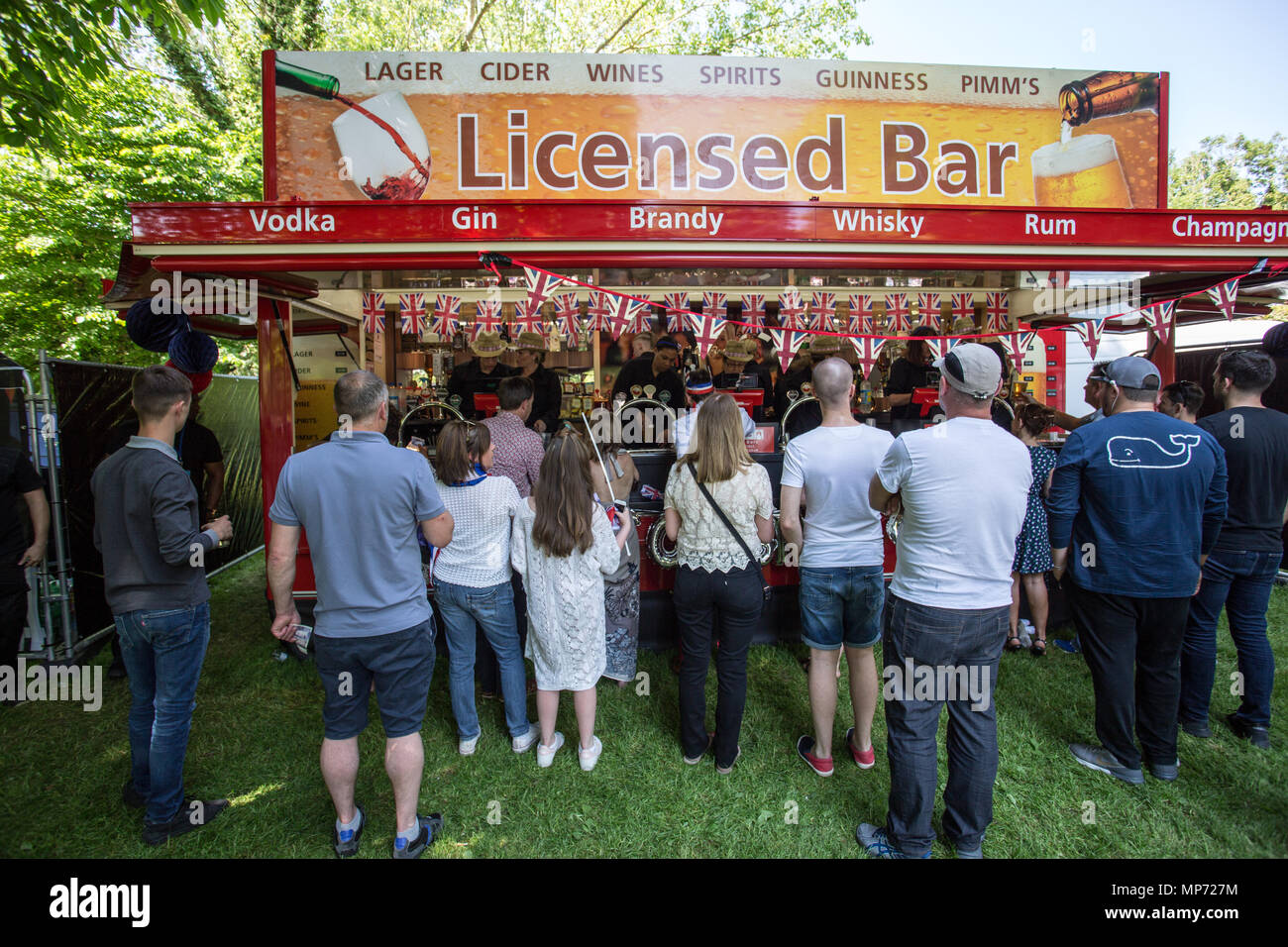 People seen lining up to buy beer. The wedding of Prince Harry and Meghan Markle was held on 19 May 2018 in St George's Chapel at Windsor Castle in the United Kingdom, ordinarily people from UK and  the rest of the world came to celebrate and enjoy the royal wedding. Stock Photo