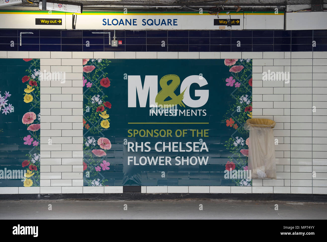 Royal Hospital Chelsea, London, UK. 22 May, 2018. Press day for the RHS Chelsea Flower Show 2018. Photo: Show Sponsor M&G Investments posters at Sloane Square underground station, the closest station to the event. Credit: Malcolm Park/Alamy Live News. - Stock Image