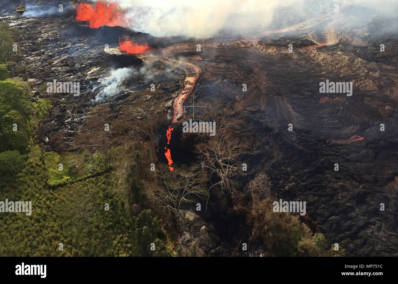 Hawaii, USA. 20th May 2018. Channelized lava streams down fissure 20 into a massive ground crack from the eruption of the Kilauea volcano May 20, 2018 in Pahoa, Hawaii. Credit: Planetpix/Alamy Live News Stock Photo