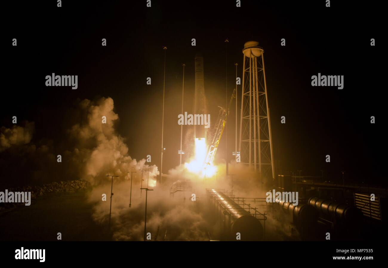 The Orbital ATK Antares rocket, with the Cygnus spacecraft onboard, blasts off from launch Pad-0A, early morning at Wallops Flight Facility May 21, 2018 in Wallops, Virginia. The Antares is carrying the Cygnus spacecraft filled with 7,400 pounds of cargo for the International Space Station on May 21st. Stock Photo