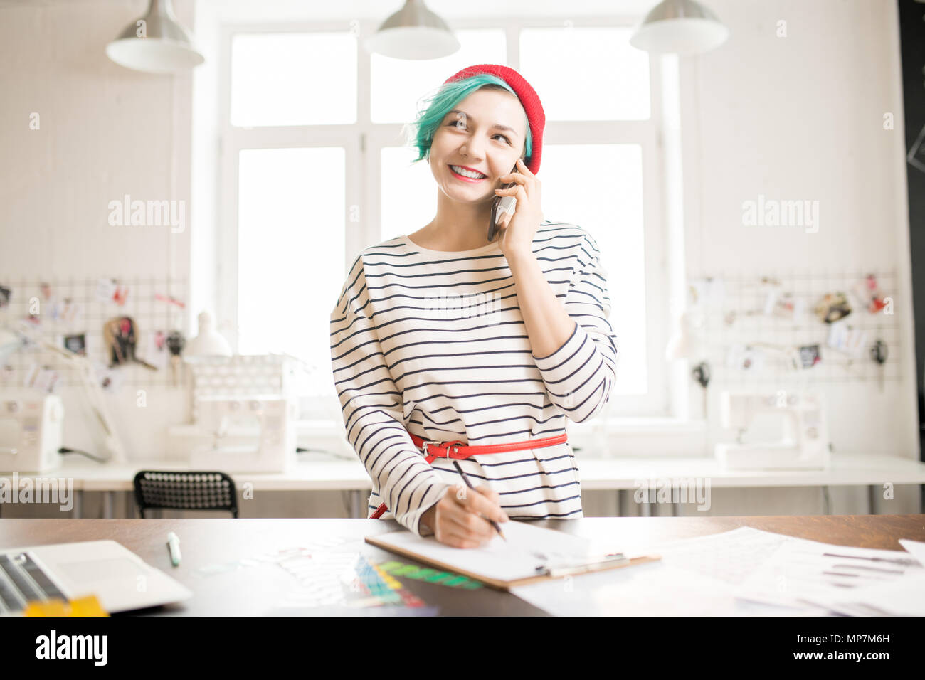 Trendy Female Manager Working in Atelier - Stock Image