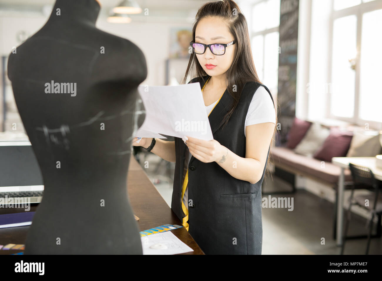 Asian Woman Working in Atelier Workshop - Stock Image