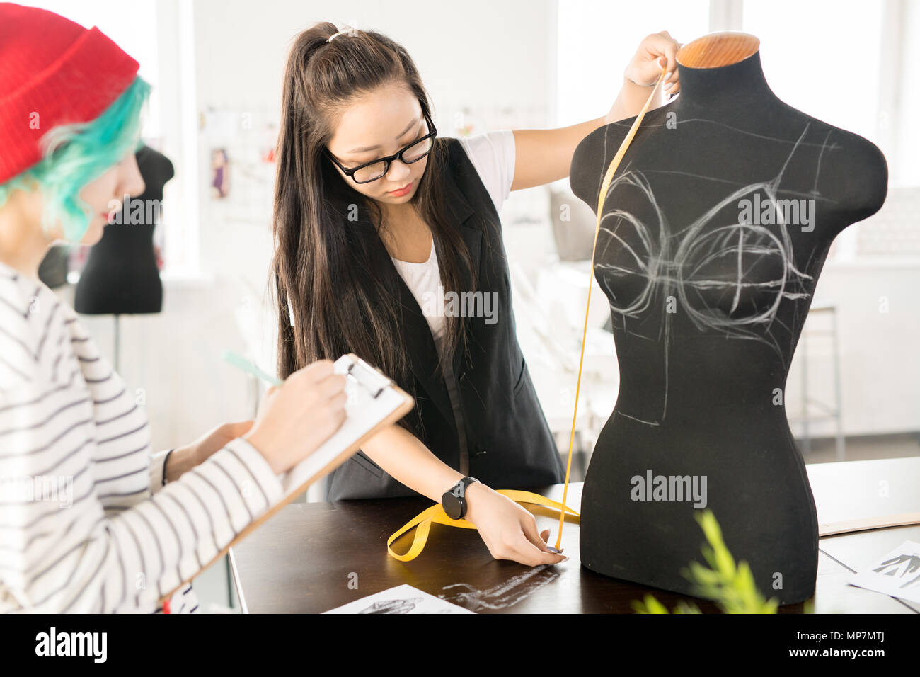 Two Creative Young Women Working in Atelier Stock Photo