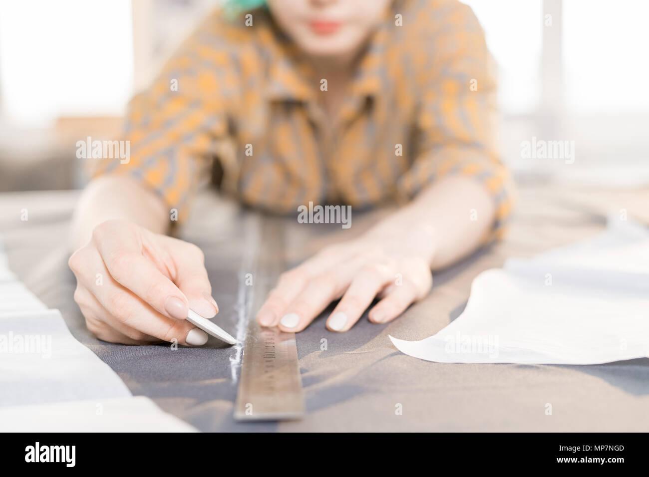 Fashion Designer Tracing Fabric - Stock Image