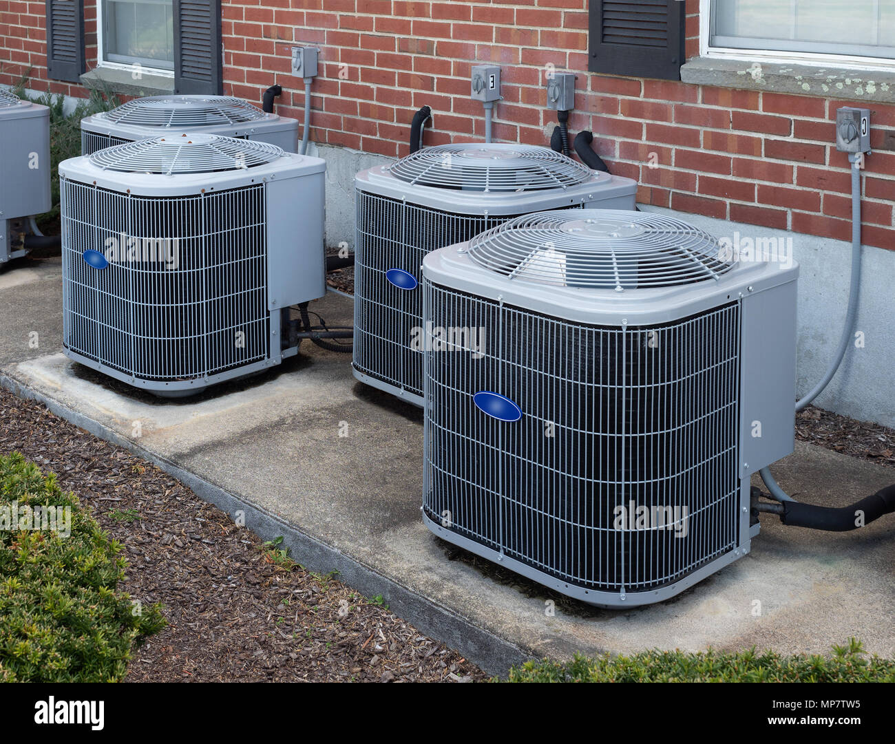 Air conditioning and heating units outside an apartment ...