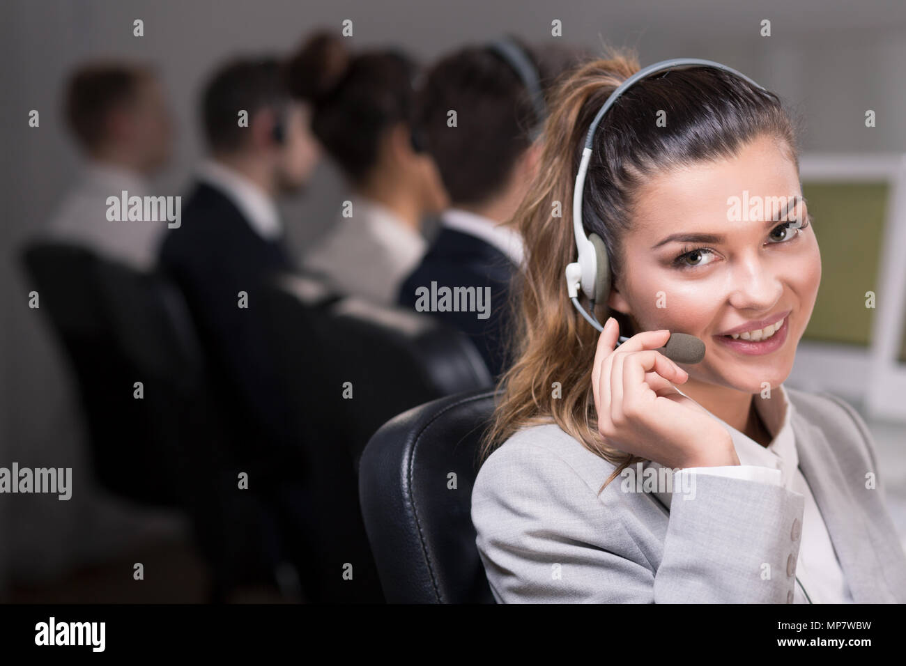 Shot of a young beautiful consultant talking with her client Stock Photo