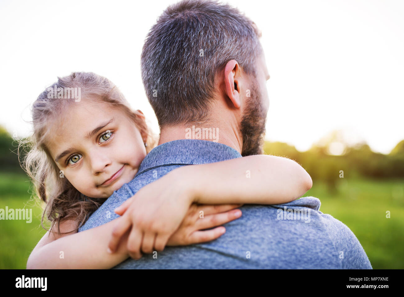 Father with a small daughter having fun in spring nature. - Stock Image