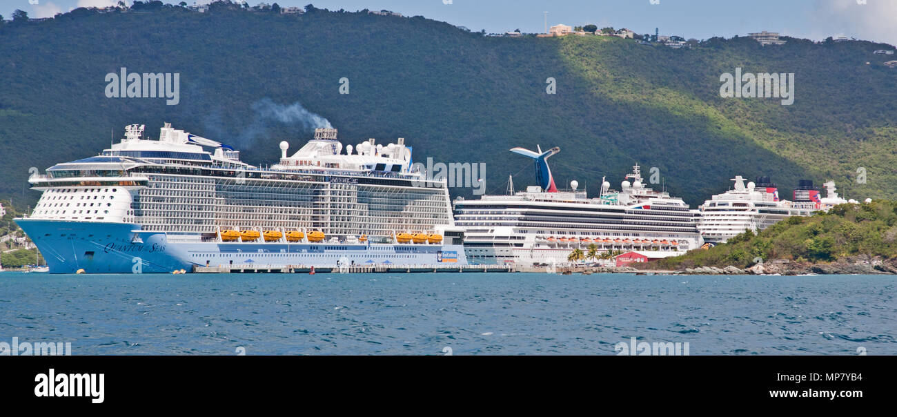 February 24, 2015- the Royal Caribbean Cruise Line Quantum of the Seas, in Virgin Islands Port with a Disney and Carnival cruise ship - Stock Image