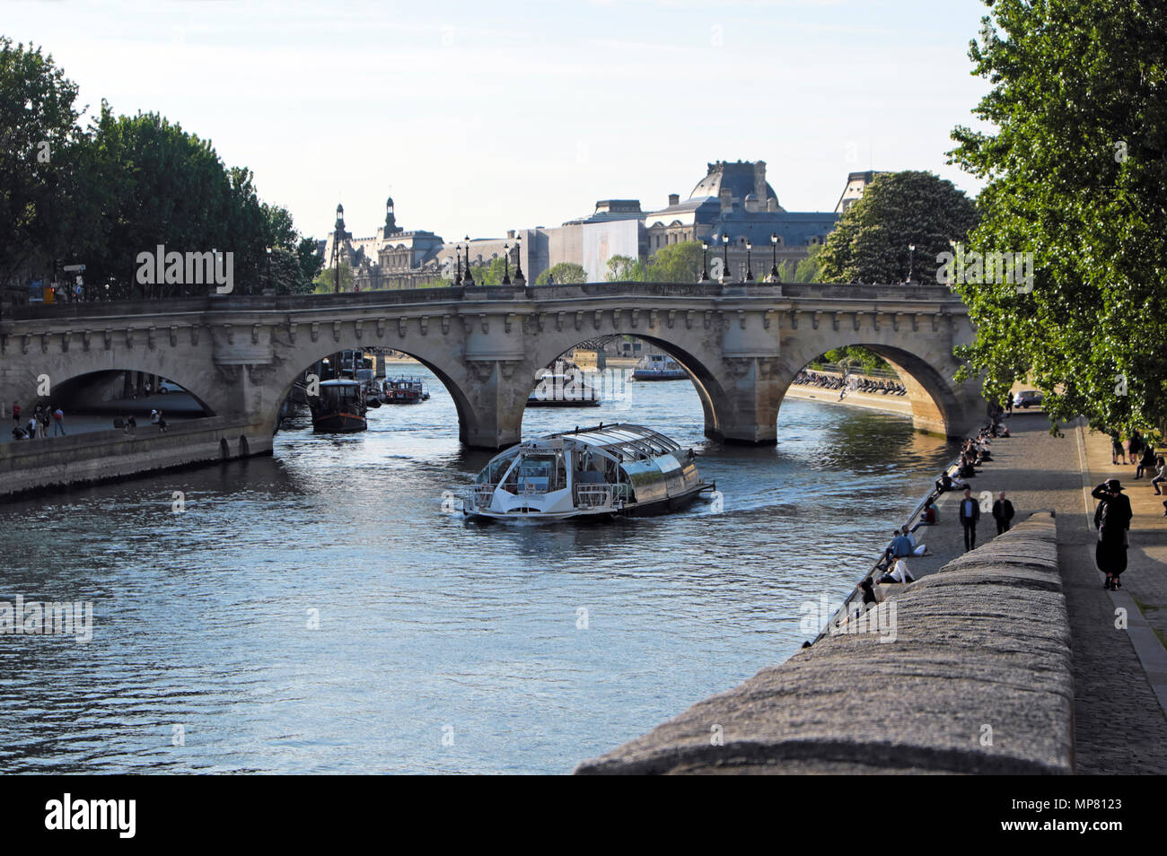 Tourist boat and view of bridge along the Left Bank of the River Seine in Paris spring  KATHY DEWITT - Stock Image