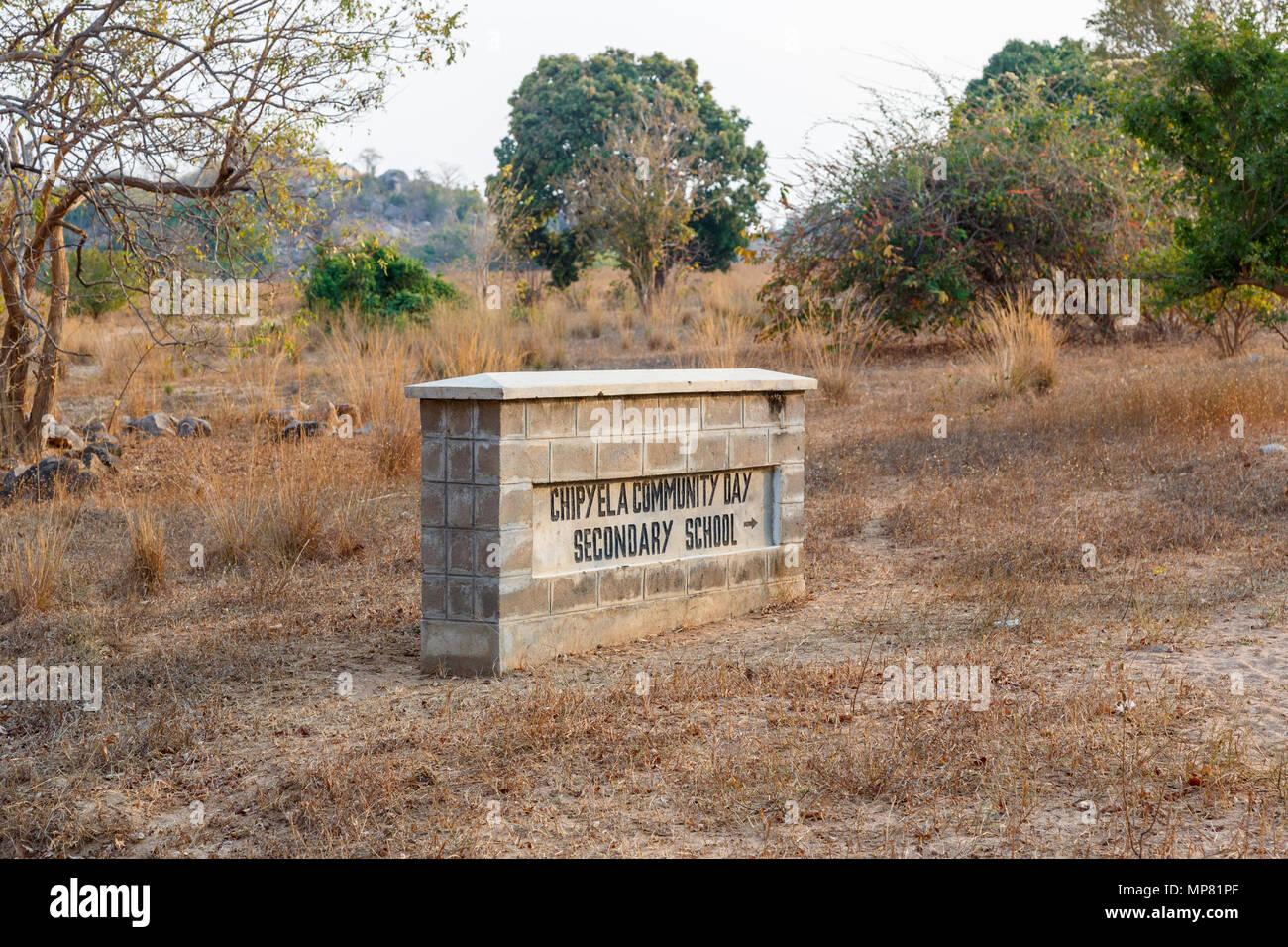 Name sign for the local Chipyela Community Day Secondary School (Mbamba) on Likoma Island, Lake Malawi, Malawi, south-east Africa Stock Photo