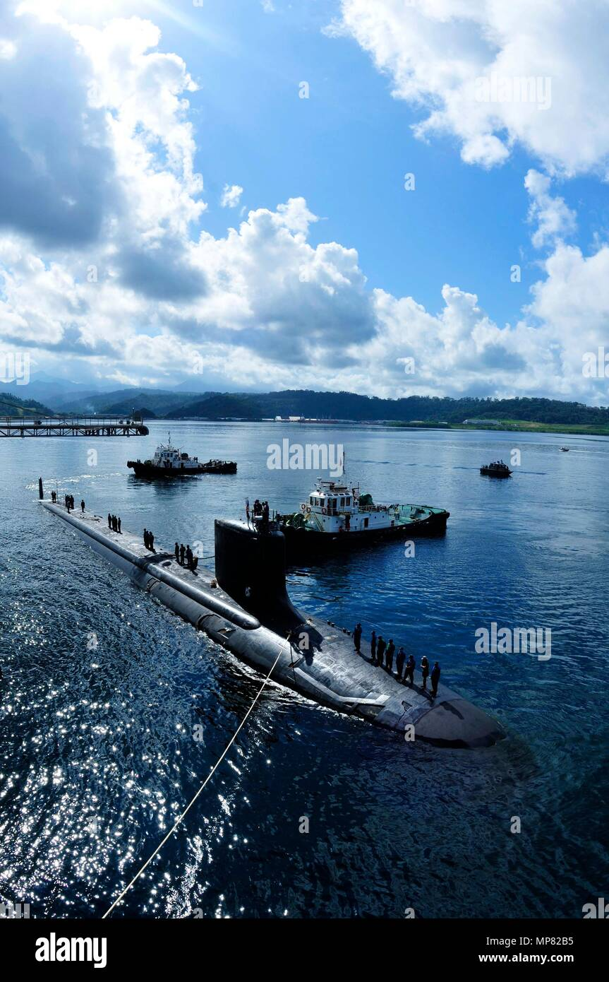 Tugboats tow the U.S. Navy Virginia-class fast-attack submarine USS Texas into port November 10, 2011 in Subic Bay, Philippines.   (photo by Chris Williamson via Planetpix) - Stock Image