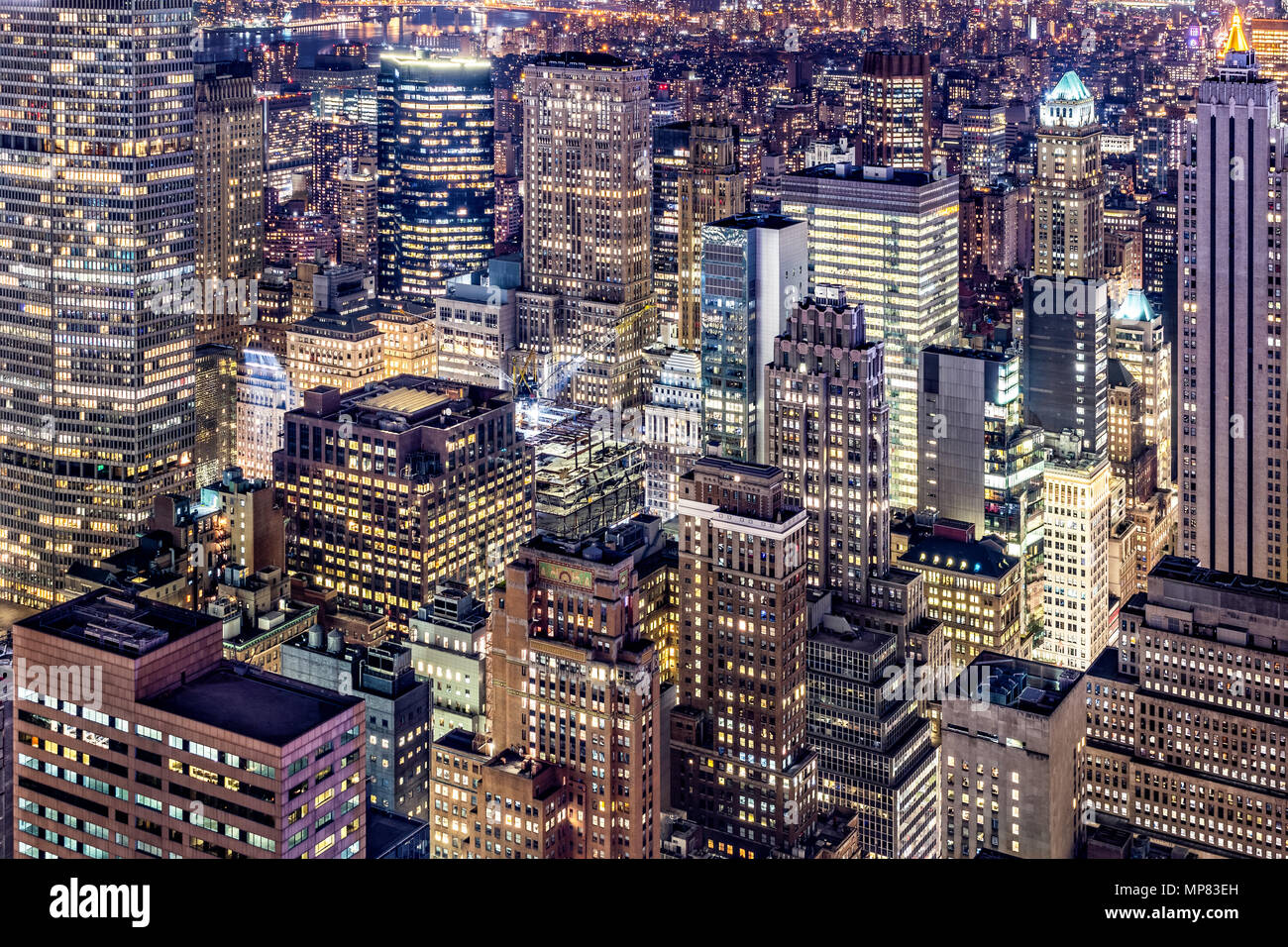 Aerial view of Manhattan skyscrapers by night - Stock Image