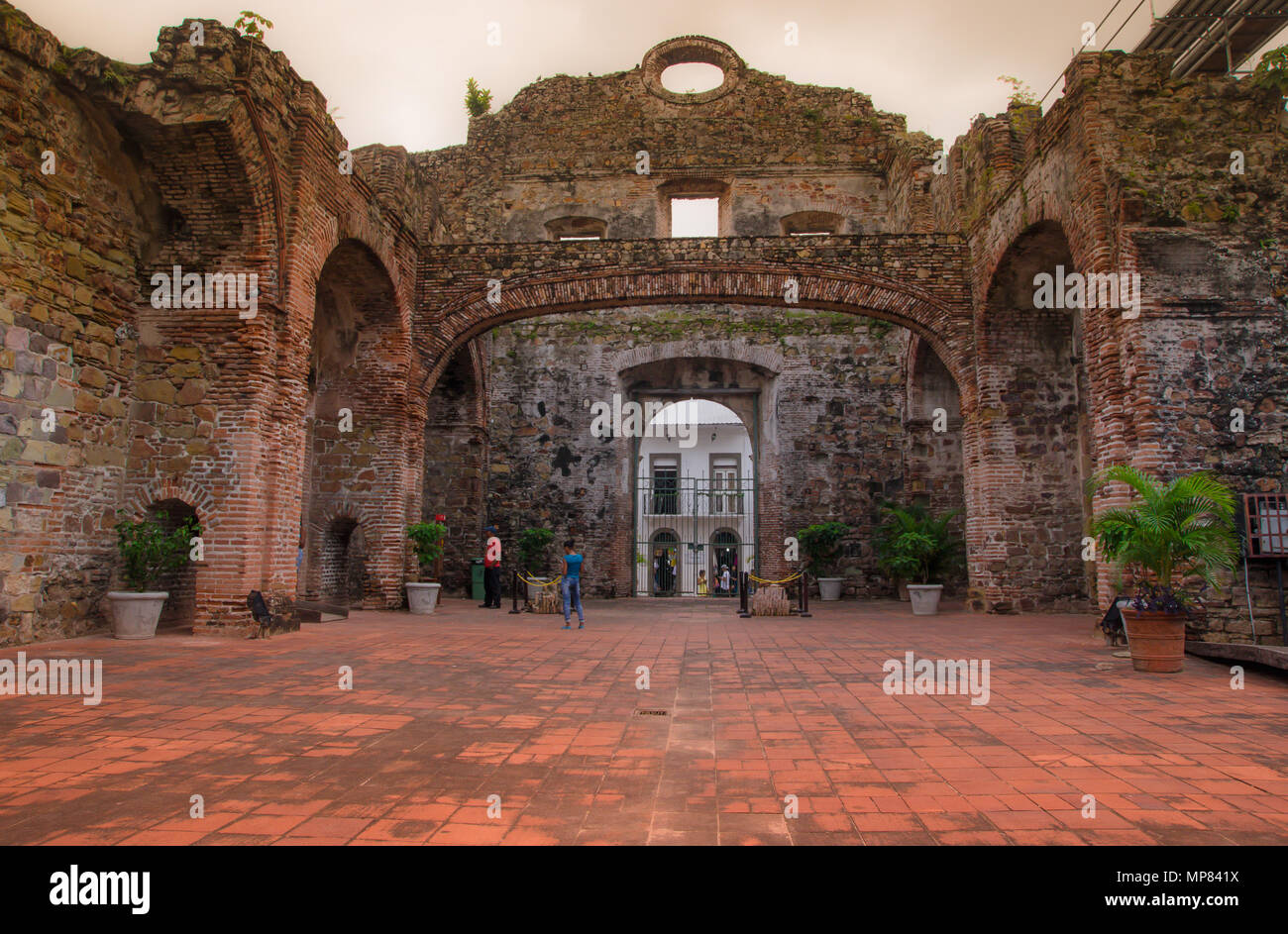 Unidentified people walking inside of ruins of the Jesuits Convent. Part of Casco Antiguo's UNESCO patrimony in old Panama city, which was destroyed by a fire in the XVIII century - Stock Image