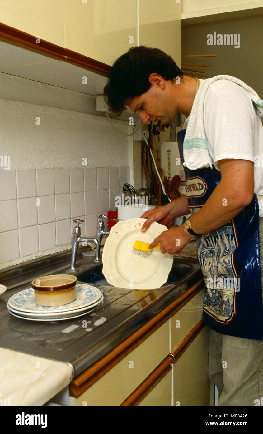 Cleaning Man Washing Dishes Kitchen Sink Stock Photo Alamy
