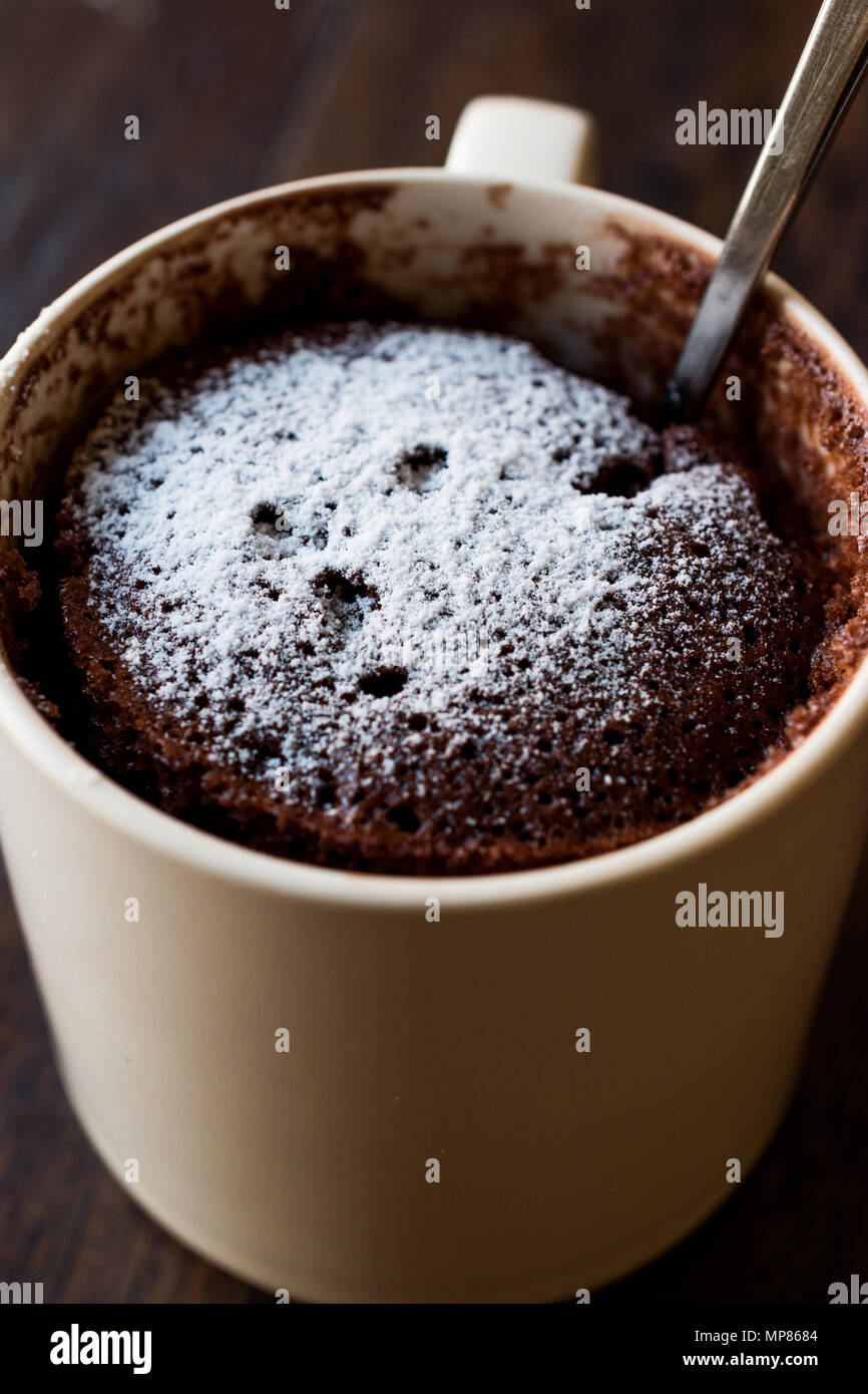 Microwave Brownie Chocolate Mug Cake With Powder Sugar On Dark Wooden Surface Dessert Concept Stock Photo Alamy