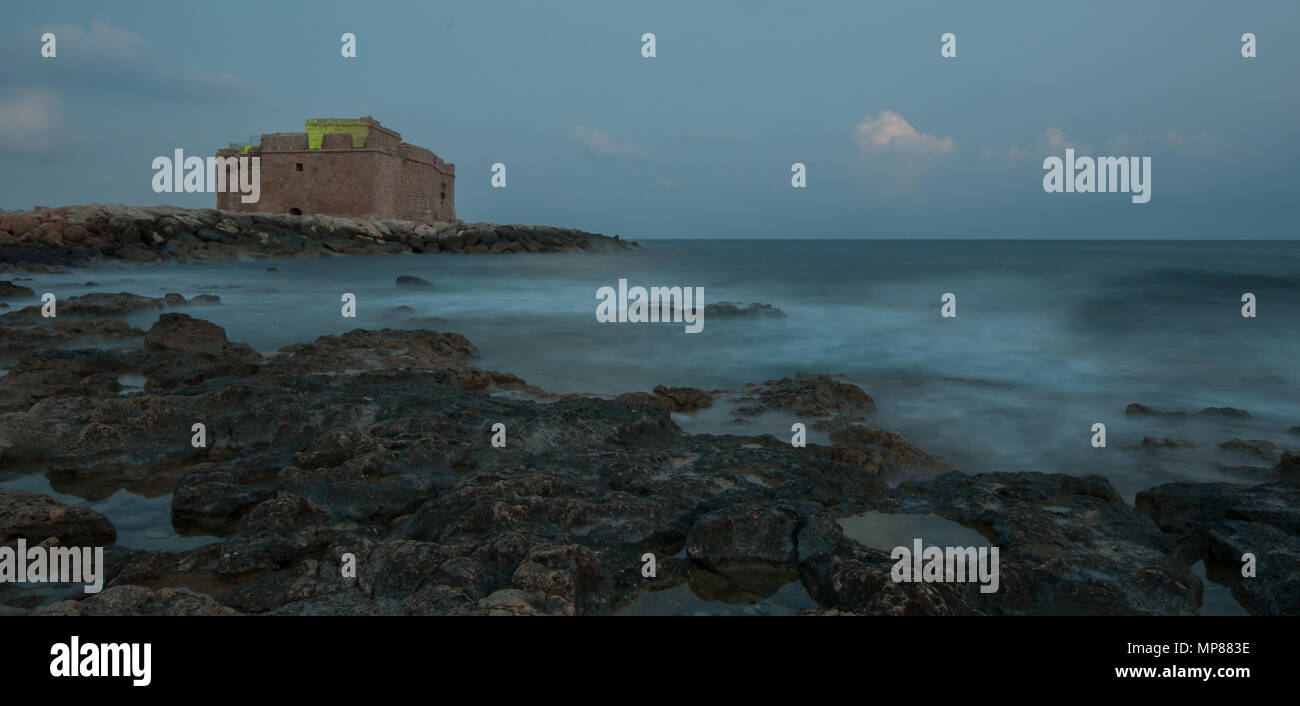 Famous Paphos medieval Castle close to the fishing harbor of Paphos late in the evening - Stock Image