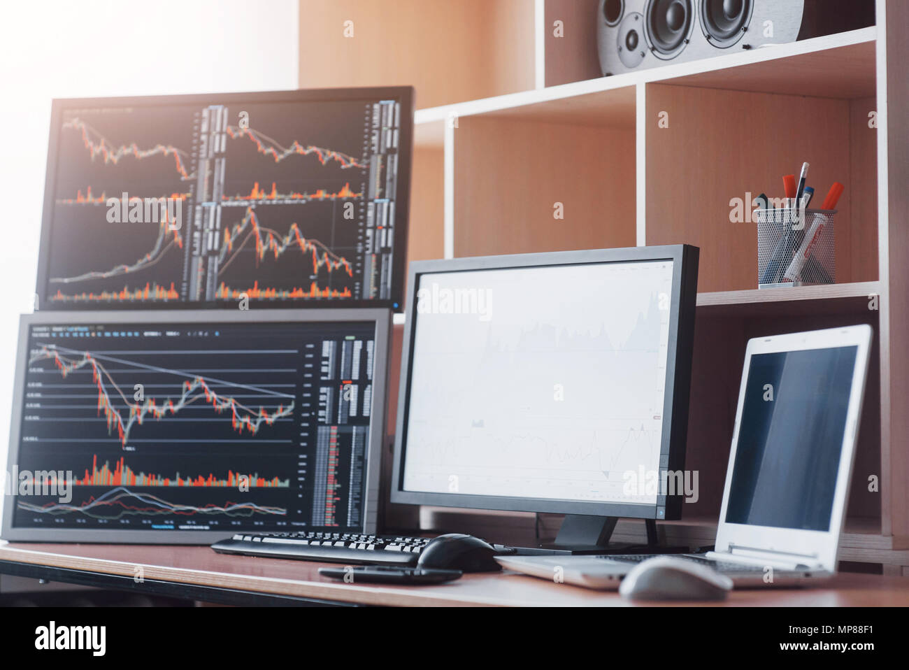 Stock exchange trader's workplace with computers - Stock Image
