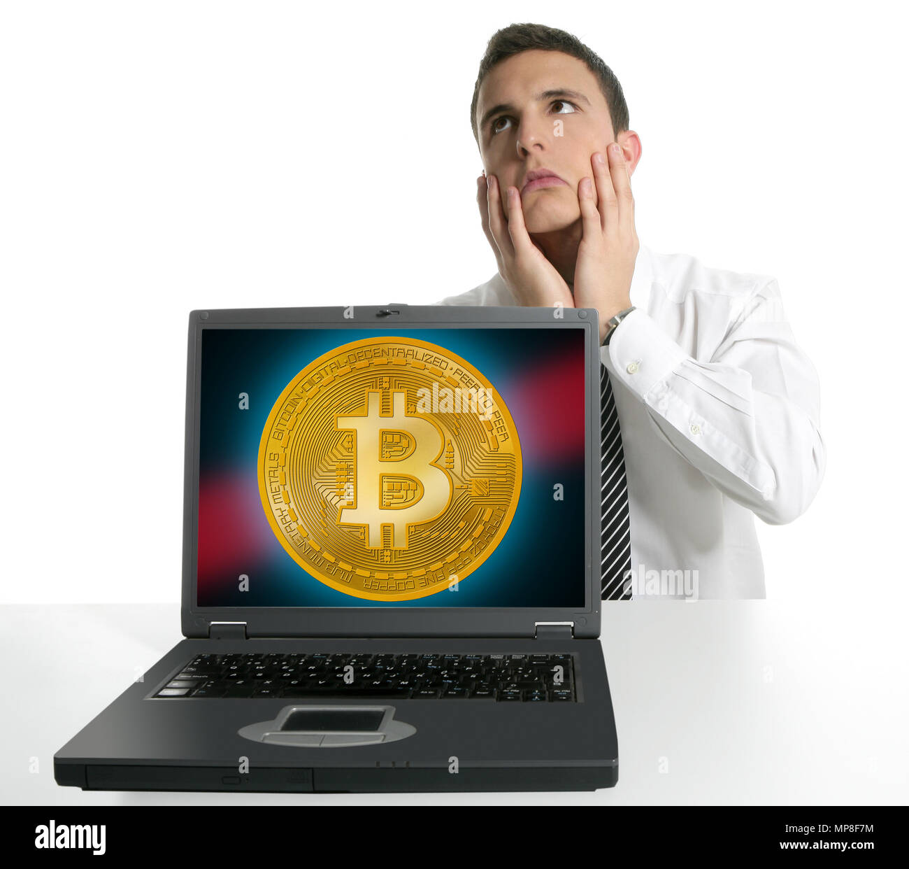 Sad businessman investing in Bitcoin BTC cryptocurrency - Stock Image