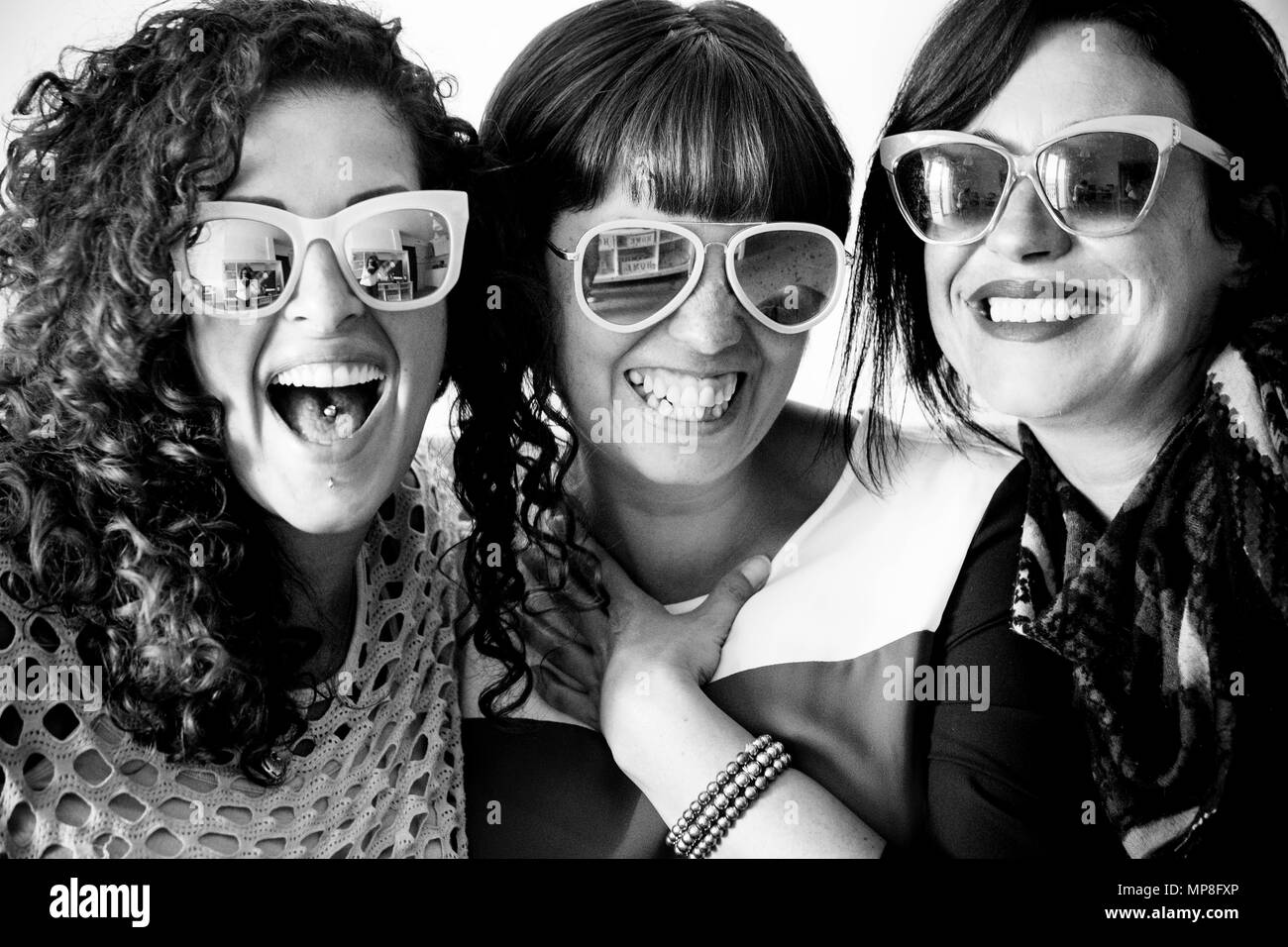 friendship for group of women people enjoy and laugh and smile together with sunglasses in craziness leisure time. funny smiles for nice beautiful lad - Stock Image