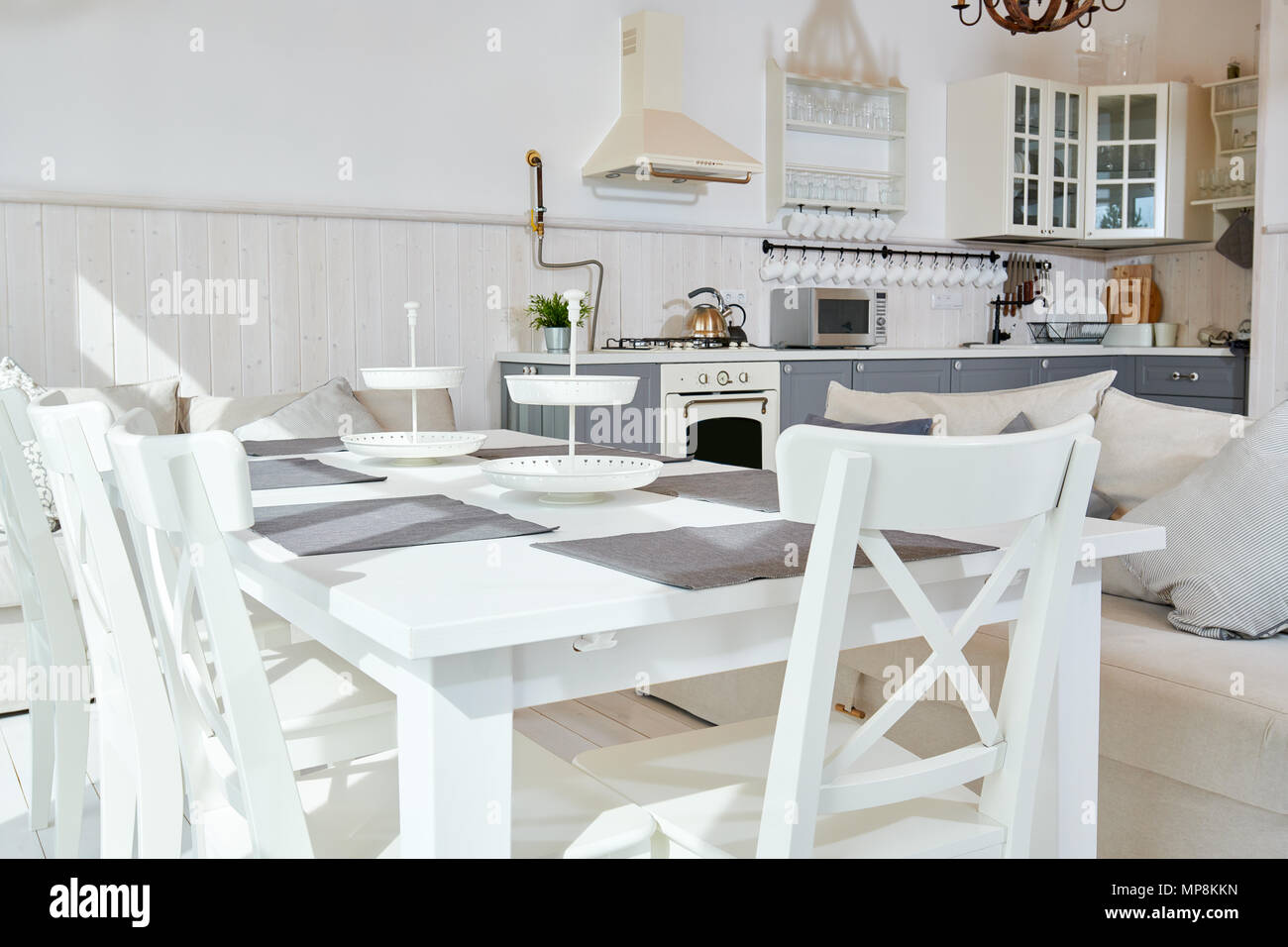 Arredare Open Space sunlit open kitchen interior design with white furniture and
