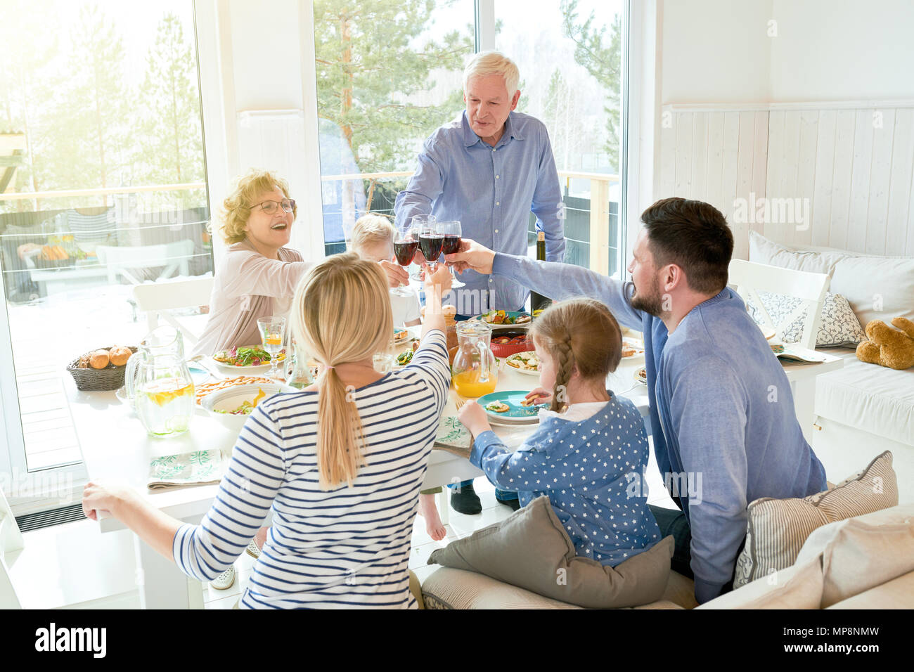 Family Gathering at Dinner - Stock Image