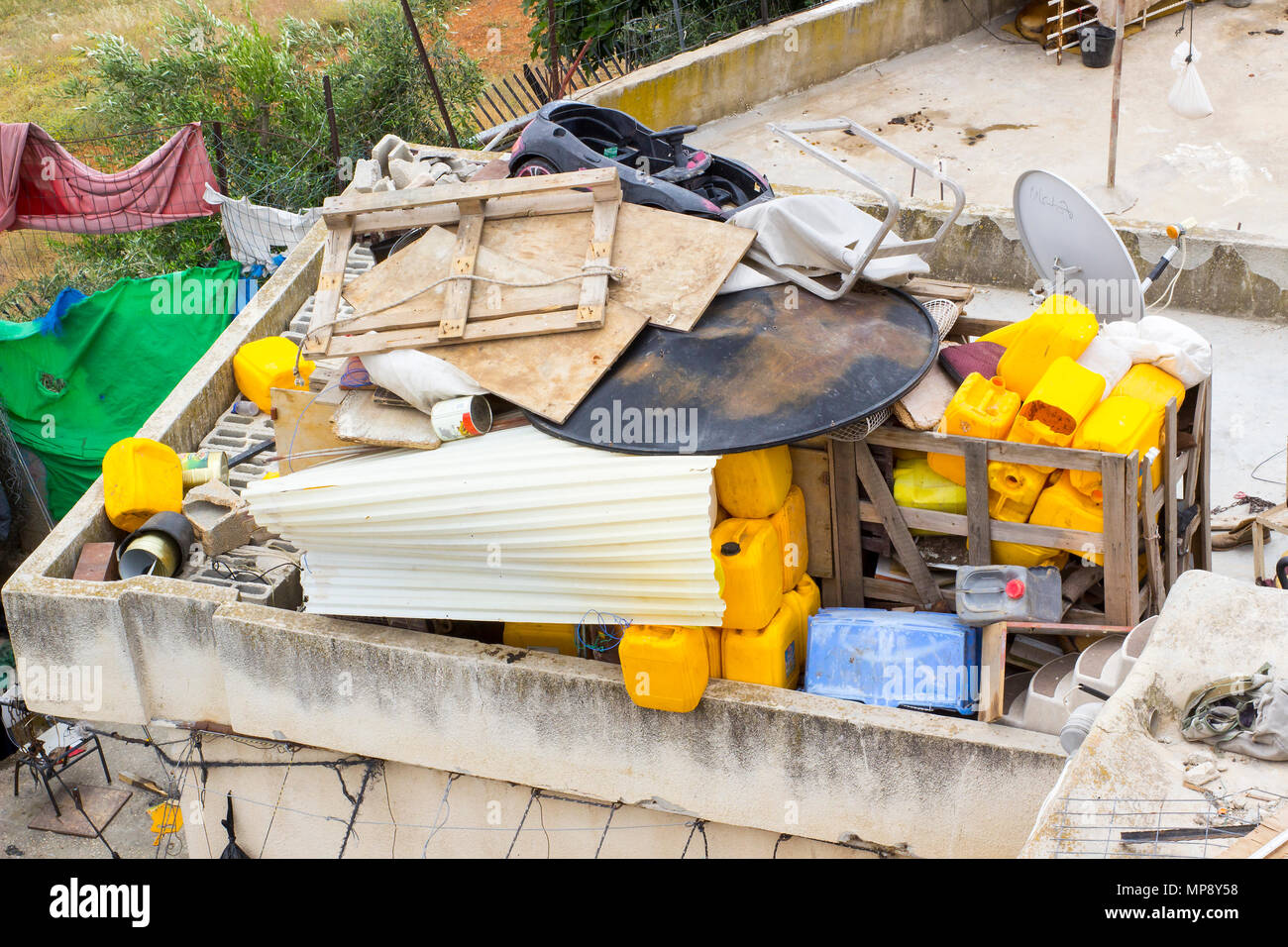 Waste thoughtlessly piled upon rooftops  of Arab homes in the city of Jerusalem and clearly visible to tourists from the rooftop of the historic Herod - Stock Image