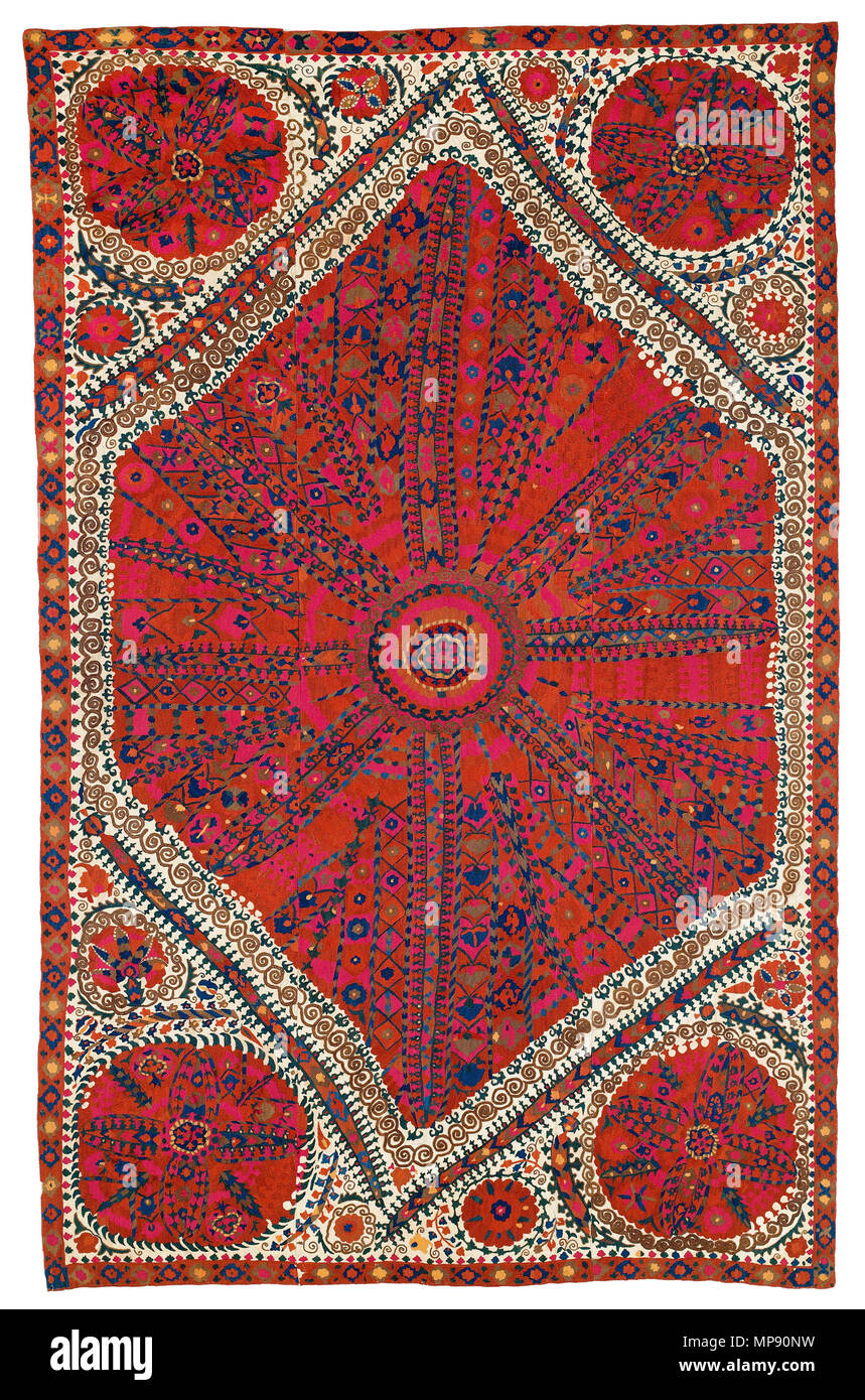 . English: VOK Collection: Suzani 47 The Vok Collection comprises two group A suzanis. Very similar in appearance, the two items are documented as A2 and A10 in the monograph, 'The Great Embroideries of Bukhara' published by Franses. The suzani A10 was sold at our first Vok auction (11th April 2015, lot 88) and discussed in detail; we refer readers to the respective catalogue entry. In comparison, A2 appears to be even more powerful than A10: it is somewhat larger in size, and the shield-shaped, fully embroidered medallion fills the field almost completely. Unlike A10, where two of the circula - Stock Image