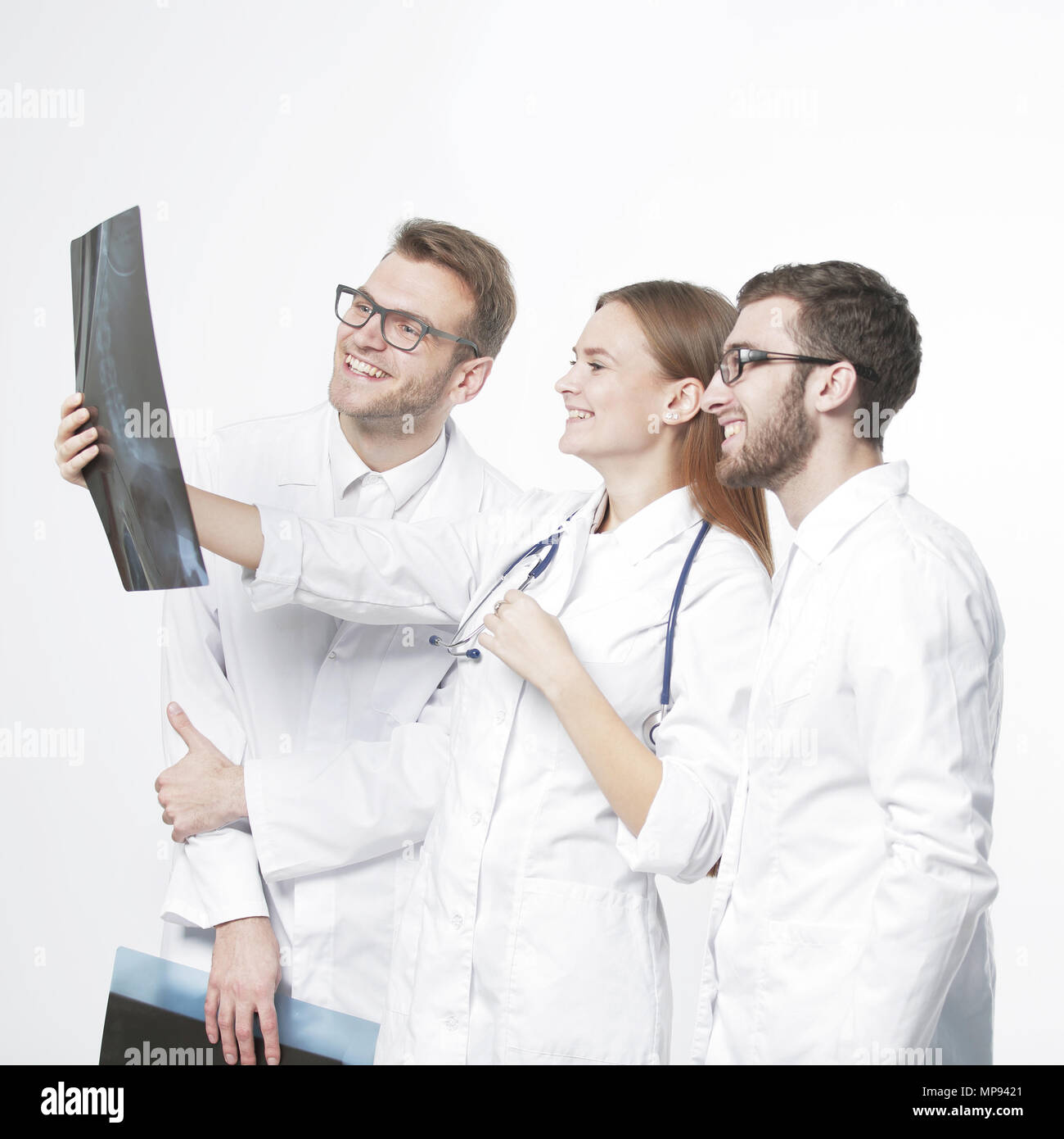 group of smiling doctors discussing x-rays .isolated on white - Stock Image